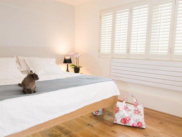 Window shutters in bedroom