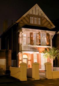 Night home lit up with beautiful shutters