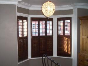 Another three section bay with shutters in wood, with a midrib for tiered opening