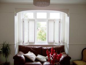 cafe style interior shutters in white