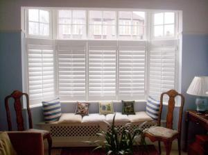Three section cheap bay window shutters with half height shutters installed