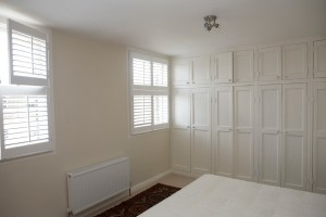 Clean lines and privacy with bedroom shutters