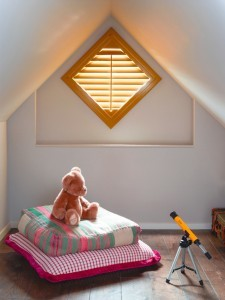 Cute nursery shutters with toys and bear