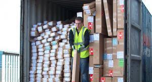 Warehouse staff unloading trade shutters