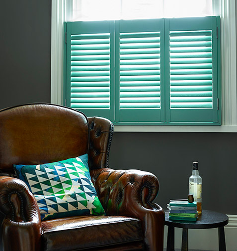Study of armchair with bright cafe shutters