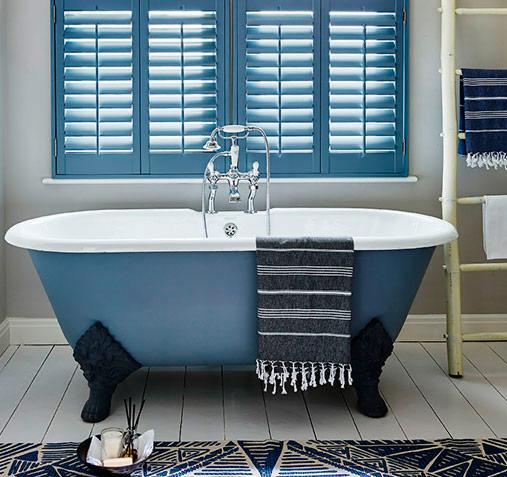 Stylish blue window shutters in blue bathroom