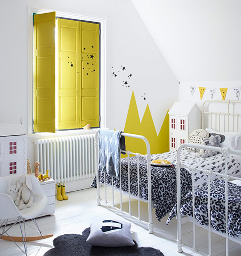 Solid wooden yellow panel shutters with painted kids bedroom