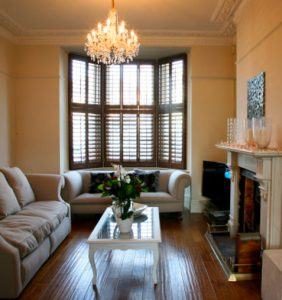 classic wooden floors into bay window with matching shutters