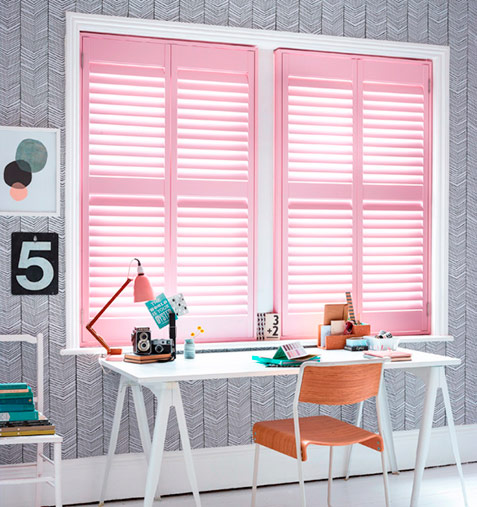 funky pink home office shutters by desk
