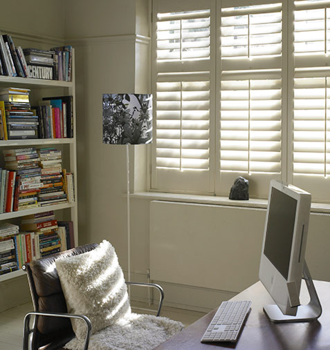 Cut down on glare in the home office with window shutters