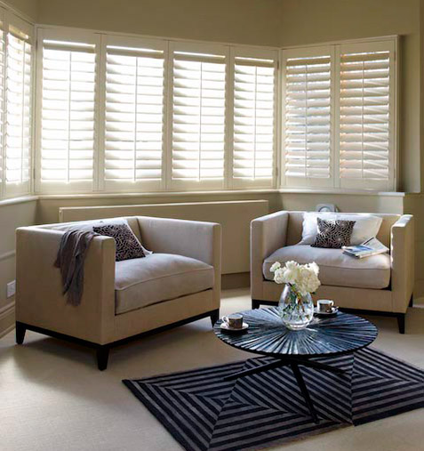 A large box bay window with shutters
