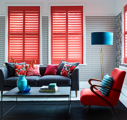 Make a statement with red window shutters in lounge