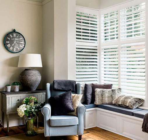 Clean looking white lounge shutters