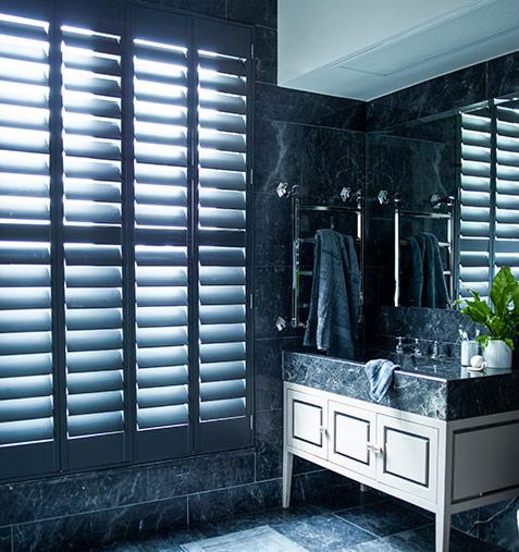 Dark bathroom and dark window shutters for a man bathroom
