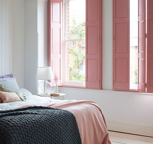 pink paint on solid shutters