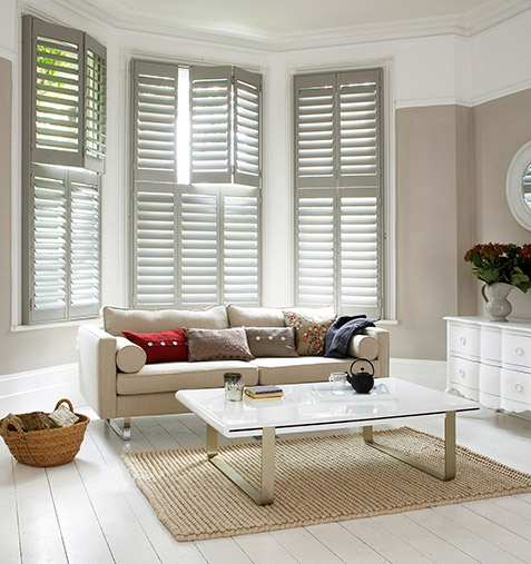 stylish lounge with large bay window and shutters