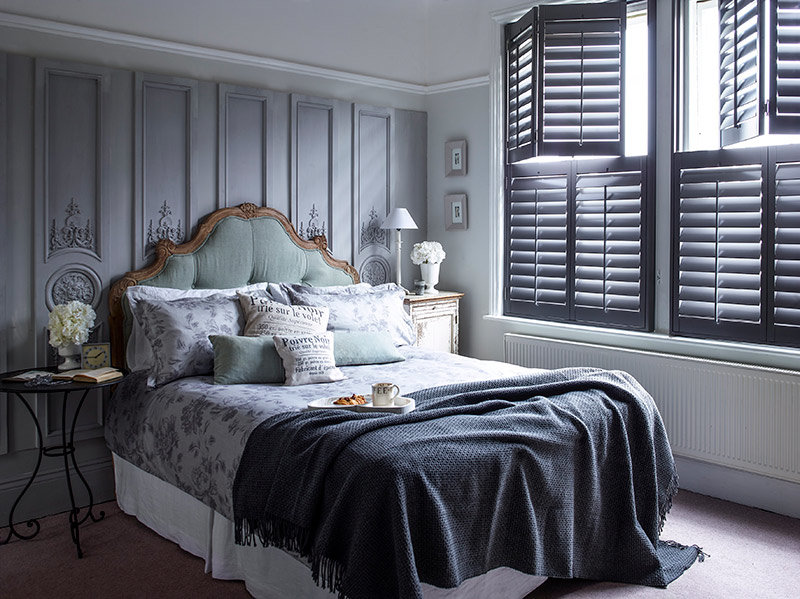 tier on tier shutters in bedroom to control light