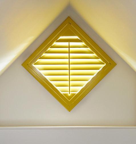 Triangular window shutters